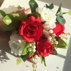 - A wedding bouquet and buttonhole collection of artificial roses