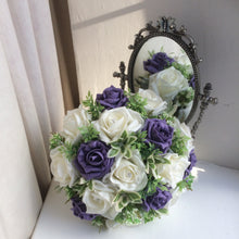 - A wedding bouquet of artificial ivory and purple roses