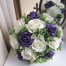 A wedding bouquet of artificial ivory and purple roses