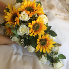 a teardrop bouquet of sunflowers and roses