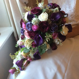 a teardrop bouquet of plum, aubergine and ivory flowers