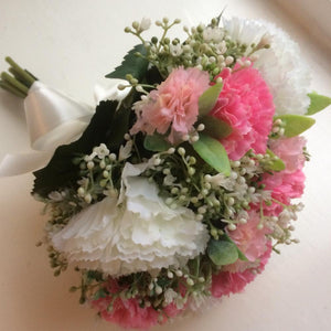 a wedding bouquet of artificial silk carnations
