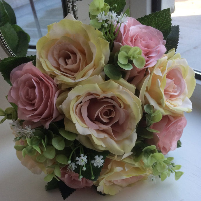 a wedding bouquet of dusky pink silk roses