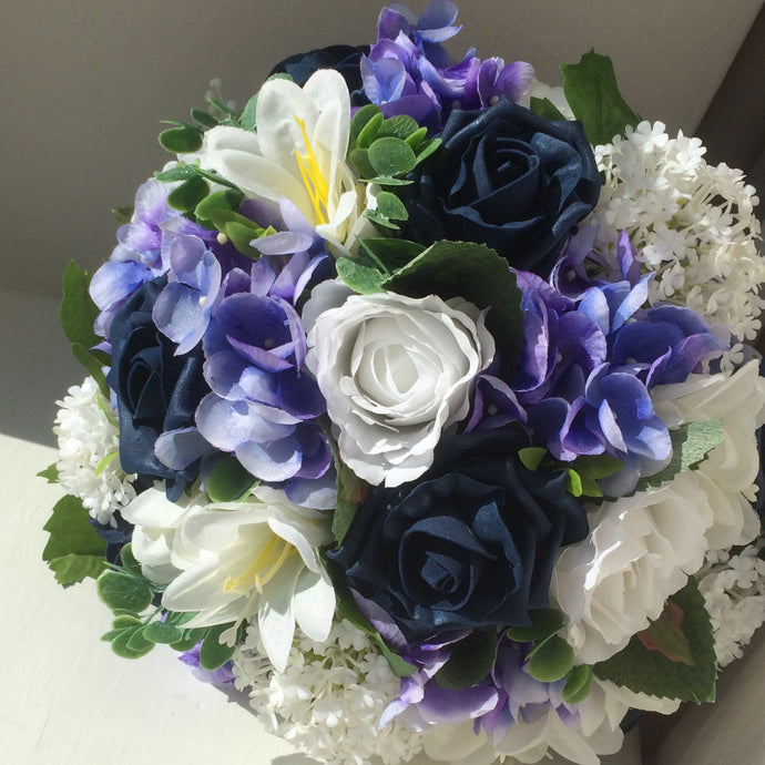 a blue and white artificial flower bouquet