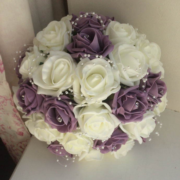artificial wedding bouquet featuring foam roses and pearl loops