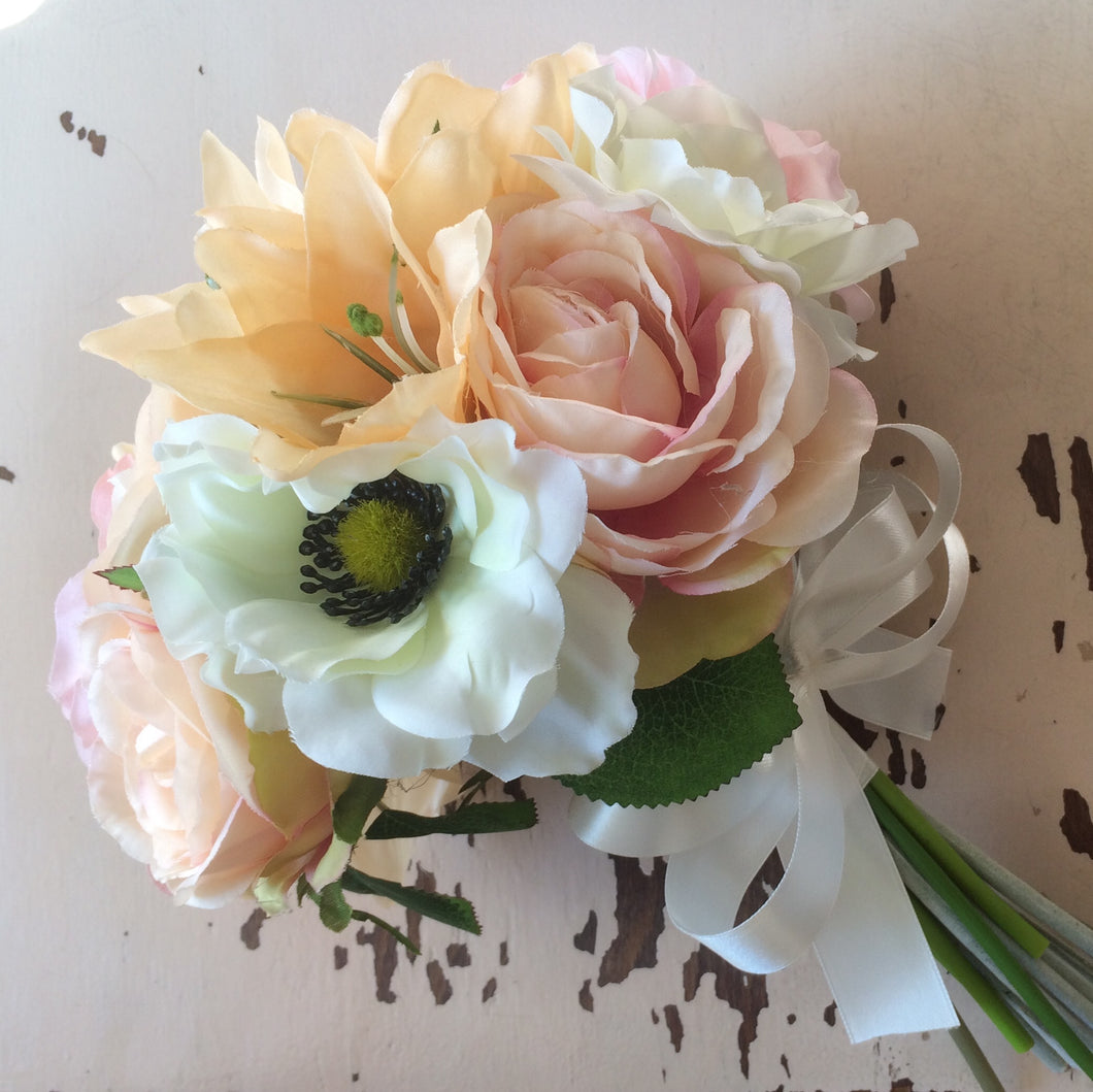 bouquet of silk flowers in shades of pink peach and blush