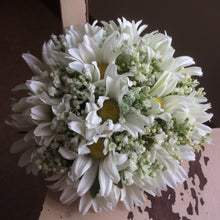 a wedding bouquet of artificial daisies and gyp
