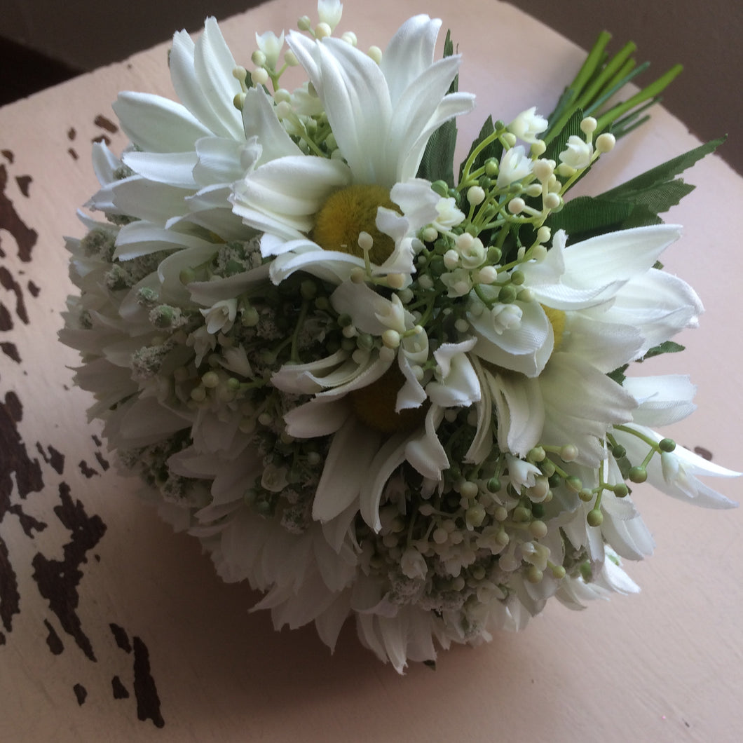 a wedding bouquet of white daisies and gypsophila