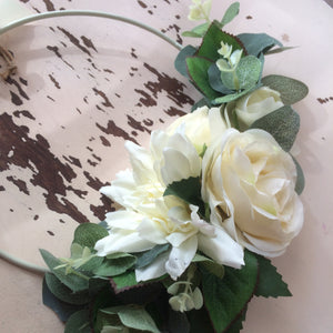 a bridesmaids hoop of artificial ivory flowers