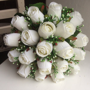 a wedding bouquet of artificial silk white roses