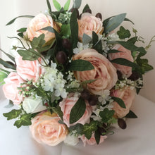 - A large wedding bouquet featuring blush and pink flowers