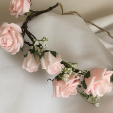 a flower crown of pale pink artificial rose flowers