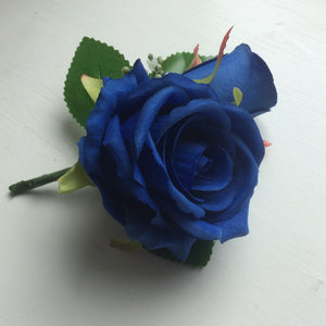 a pin on corsage featuring silk roses (different colours available)