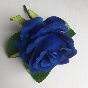 a buttonhole featuring a single silk rose (different colours available)