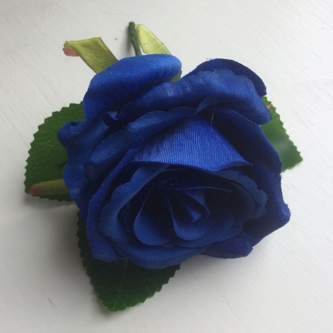 a traditonal silk rose buttonhole