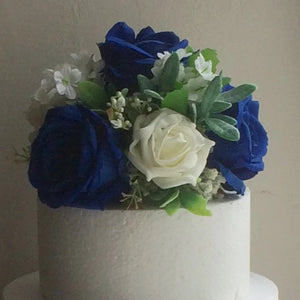 A cake topper of artificial roses (choice of colours)