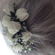 a floral hair comb featuring ivory roses & crystals