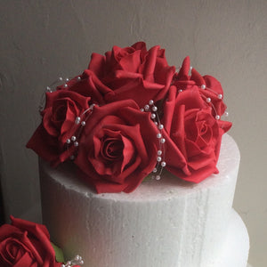 a cake topper featuring artificial foam roses (choice of colours)