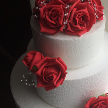 cake decorations of artificial foam roses and pearls