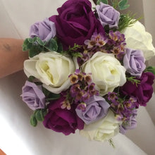 A wedding bouquet of artificial purple, lilac and ivory roses