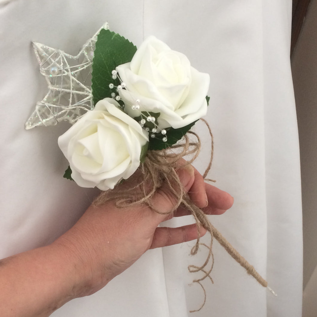 artificial ivory roses and twine decorate this metal ivory star wand