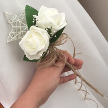 A bridesmaids star wand with ivory roses & hessian handle