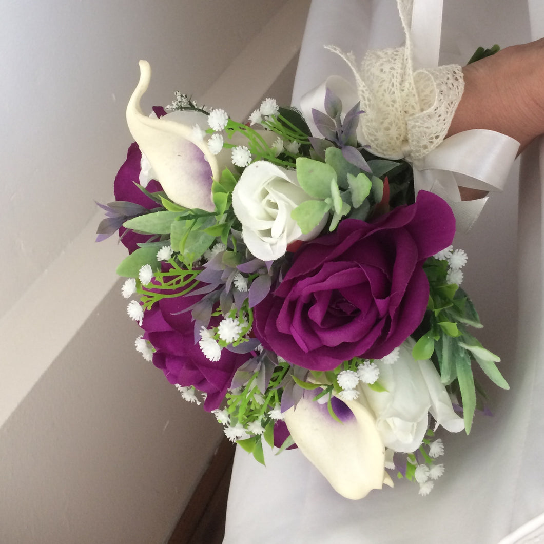 wedding bouquet featuring calla lilies and rose in shades of purple