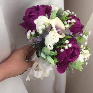 A wedding bouquet of purple and ivory silk flowers