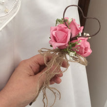 A dainty bridesmaids wand with pink roses, gyp & jute handle