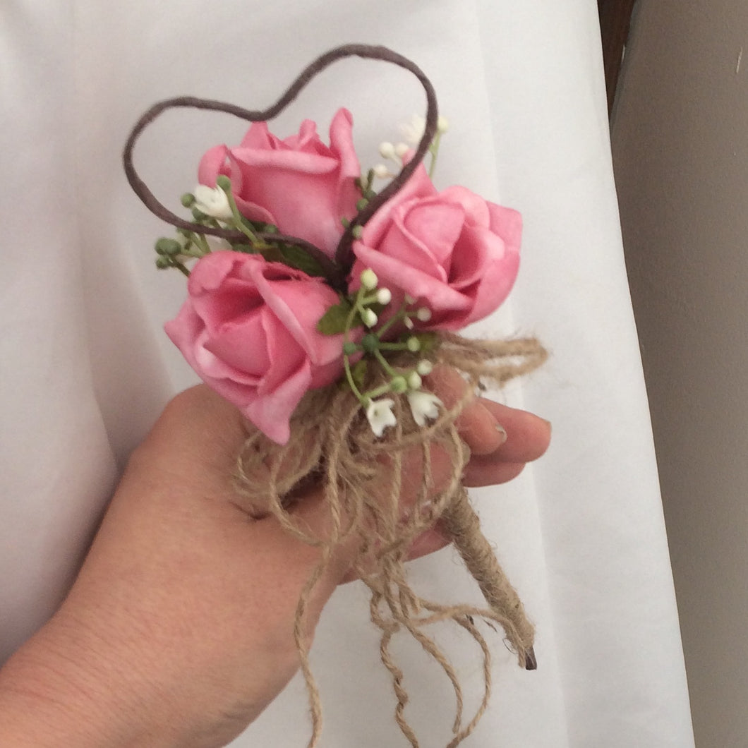 a dainty bridesmaid want featuring gyp and pink foam roses