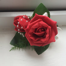 a corsage featuring foam roses in a choice of 35 colours