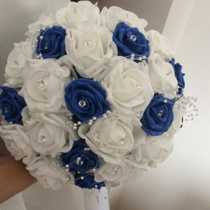 a wedding bouquet of royal blue and white foam roses