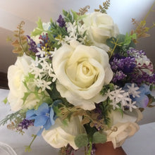 artificial flower wedding bouquet in shades of blue purple and ivory