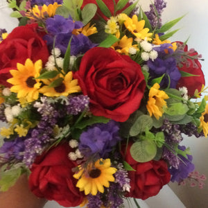 A bouquet for the bride featuring red, orange and purple artificial silk flowers