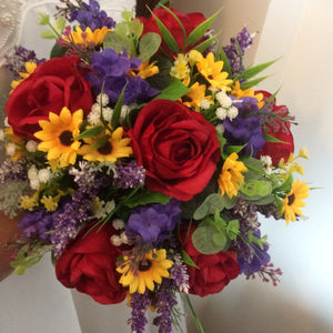 brides bouquet of artificial red, purple and yellow flowers