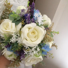 A bouquet for the bride featuring ivory blue & purple artificial silk flowers