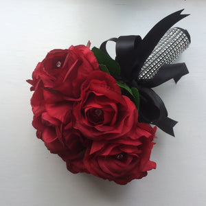 a brides bouquet of artificial silk red roses with diamante