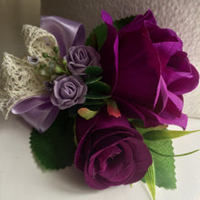 a corsage of purple and lilac roses