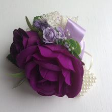 a wrist corsage featuring artificial flowers