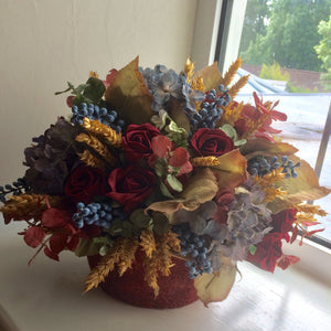 autumn arrangement of artificial flowers