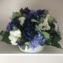 flower arrangement of blue navy and ivory flowers