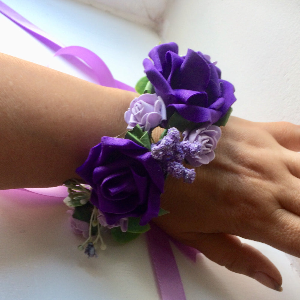 a circlet of purple and lilac flowers for the wrist