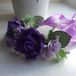 a half circlet of Purple and lilac roses
