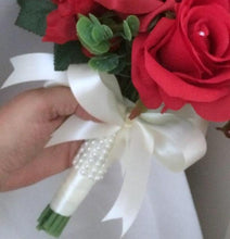 a wedding bouquet of artificial red silk roses & tulip flowers