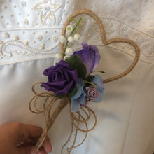 a jute bound heart shaped bridesmaid wand