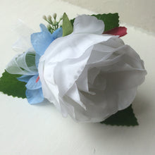 a white rose buttonhole