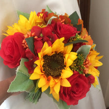 a brides wedding bouquet featuring artificial hydrangea, roses & sunflowers