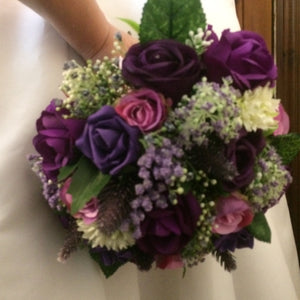 a bridal bouquet of purple and lilac flowers