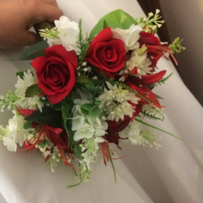 wedding bouquet using red and ivory silk flowers