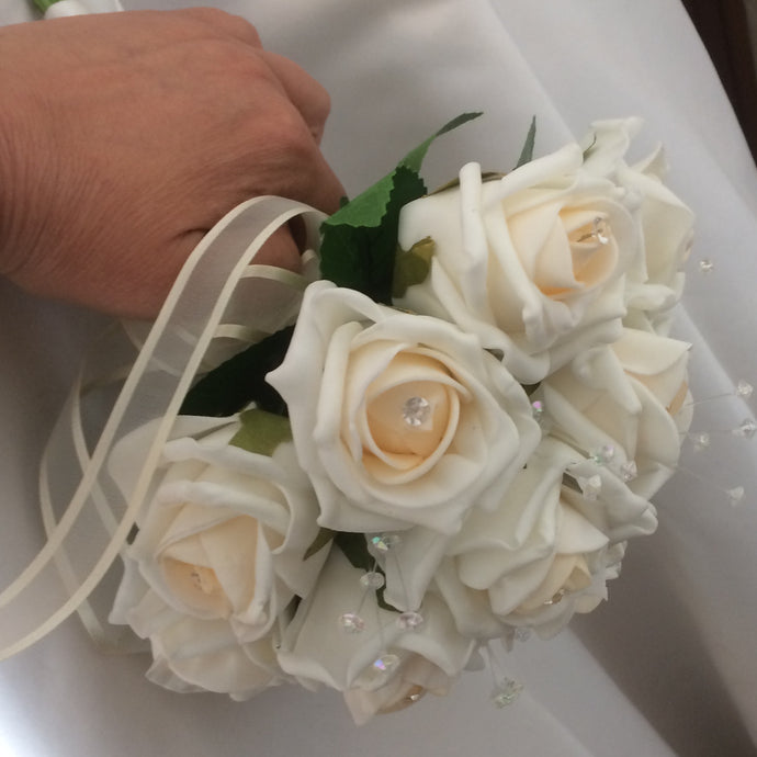a wedding bouquet of blush champagne foam roses